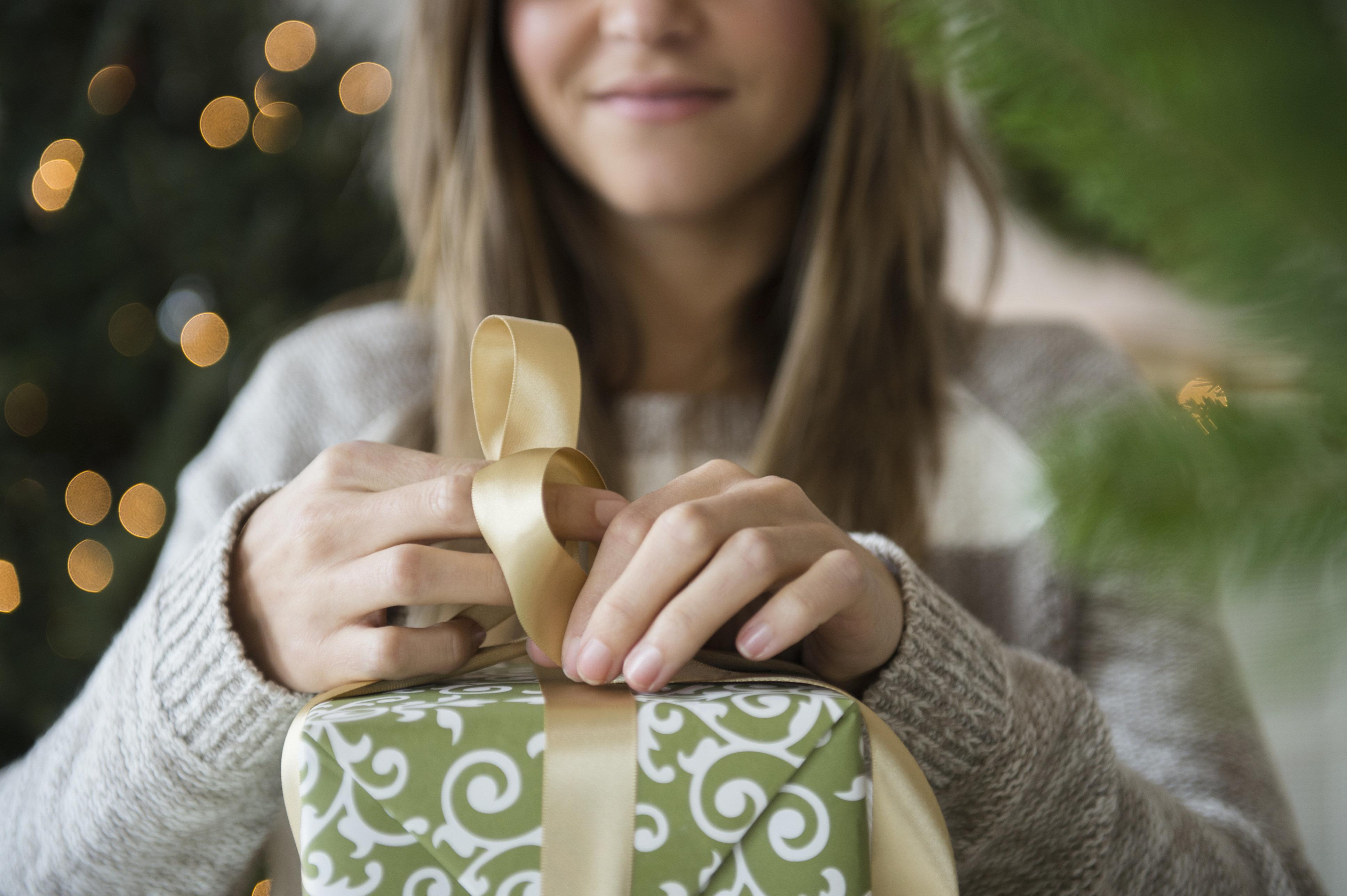 Woman preparing christmas gifts