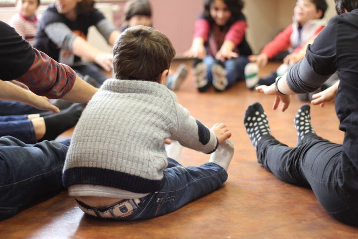 Syrian refugee children take part in a dance and movement exercise at a Project Lift workshop.