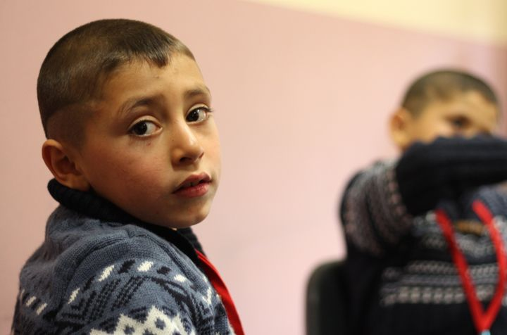 A Syrian boy participates in a music exercise during a Project Lift workshop.