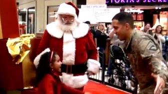 Santa helped Trent Baskerville surprise his daughters at the mall