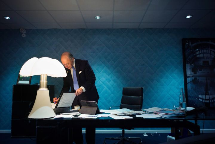 French Foreign Affairs minister Laurent Fabius works in his office during the COP 21 United Nations Conference on climate cha