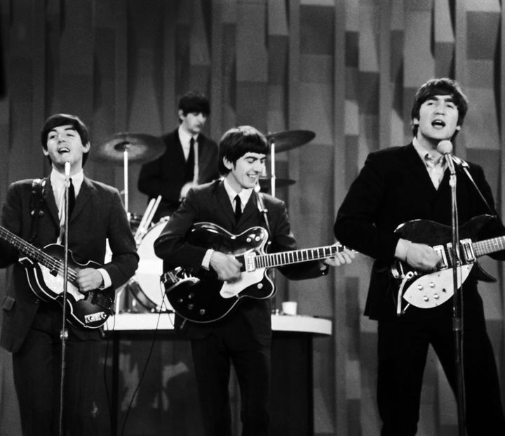 John Lennon Right Pictured Singing With The Beatles On Ed Sullivan Show