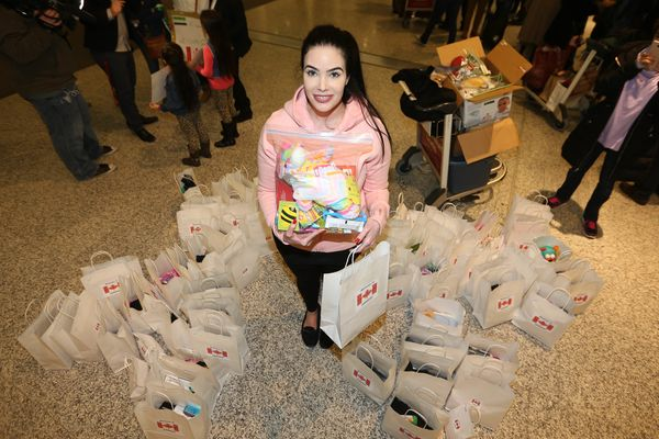 Stefania Dunlop is part of a local group that brought packages for refugees arriving in Canada.