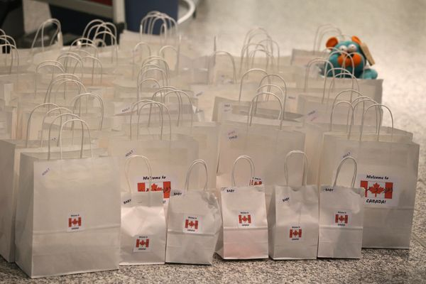A local Toronto group put together gift bags for arriving refugees. The bags had items added as people arrived to greet the r