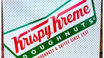 Santa Monica, Ca - April 16, 2015. A box of Krispy Kreme doughnuts.