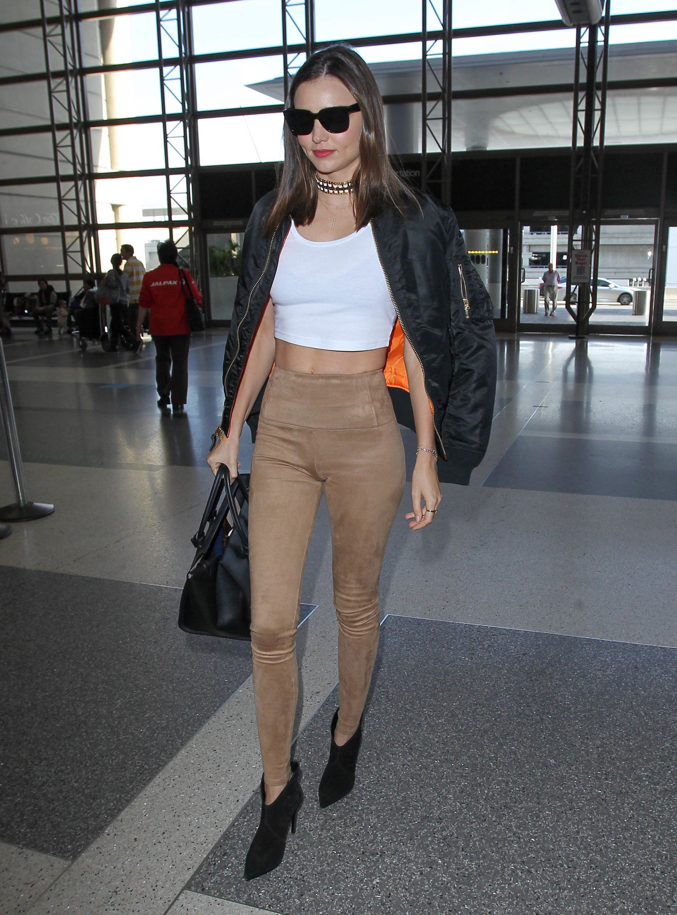 51922773 Model and busy mom Miranda Kerr departing on a flight at LAX airport in Los Angeles, California on December 5, 2015. FameFlynet, Inc - Beverly Hills, CA, USA - +1 (818) 307-4813