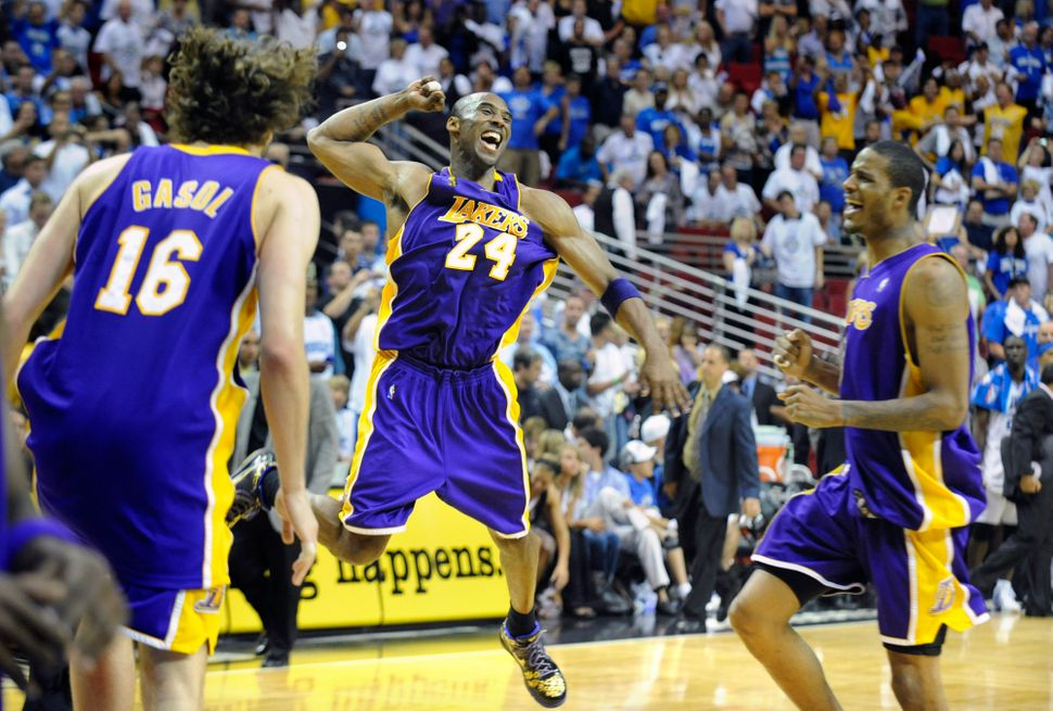 Bryant celebrates the Lakers winning the 2008-2009 NBA championship, on June 14, 2009, in Orlando, Florida. Bryant won F
