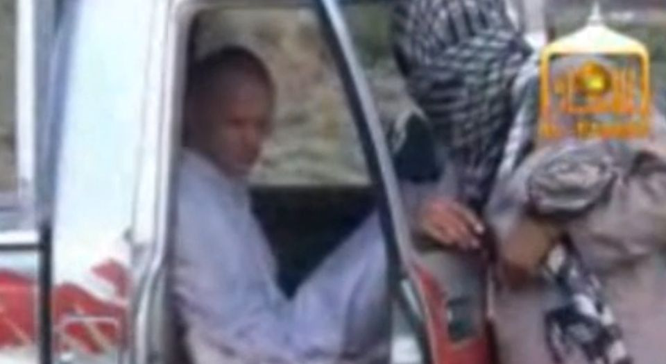 After five years in captivity, Bowe Bergdahl waits in a truck, dressed in white, with his Taliban captors for the American he