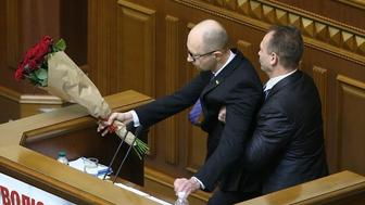 KIEV, UKRAINE - DECEMBER 11: Verkhovna Rada (R), deputy Oleh Barna from the faction of the Petro Poroshenko Bloc, attacks Ukrainian Prime Minister Arseniy Yatsenyuk (L) during the report of the Cabinet of Ministers in the Parliament on December 11, 2015 in Kiev, Ukraine. (Photo by Nosach Vitaliy/ukrafoto.com/Anadolu Agency/Getty Images)