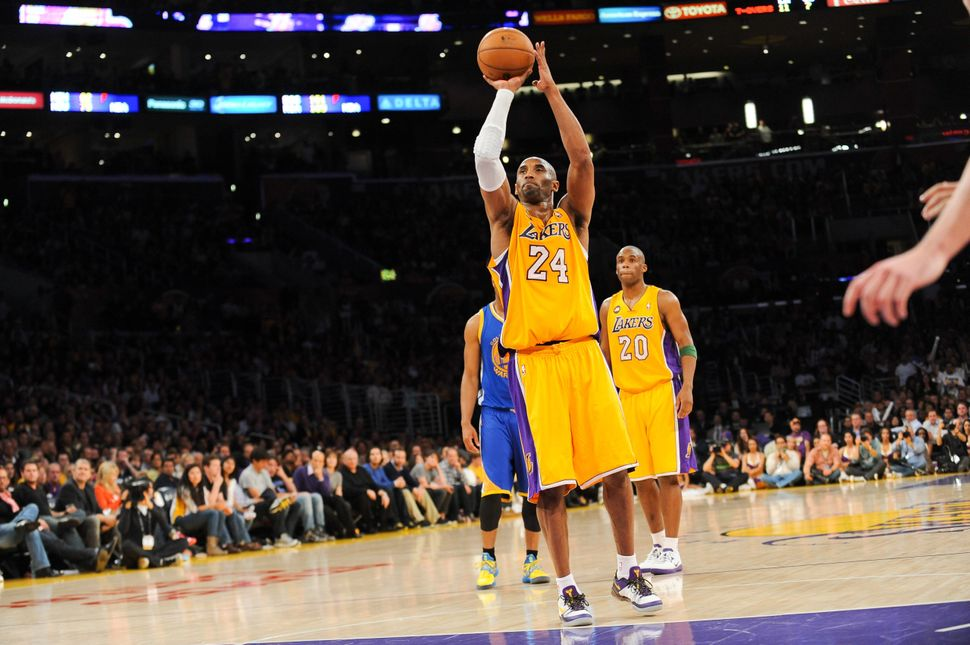 Moments aftertearing his Achilles on April 12, 2013, Bryant somehow manages to sink two free throws before leaving the
