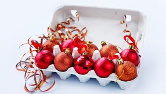 Christmas balls in paper eggs box