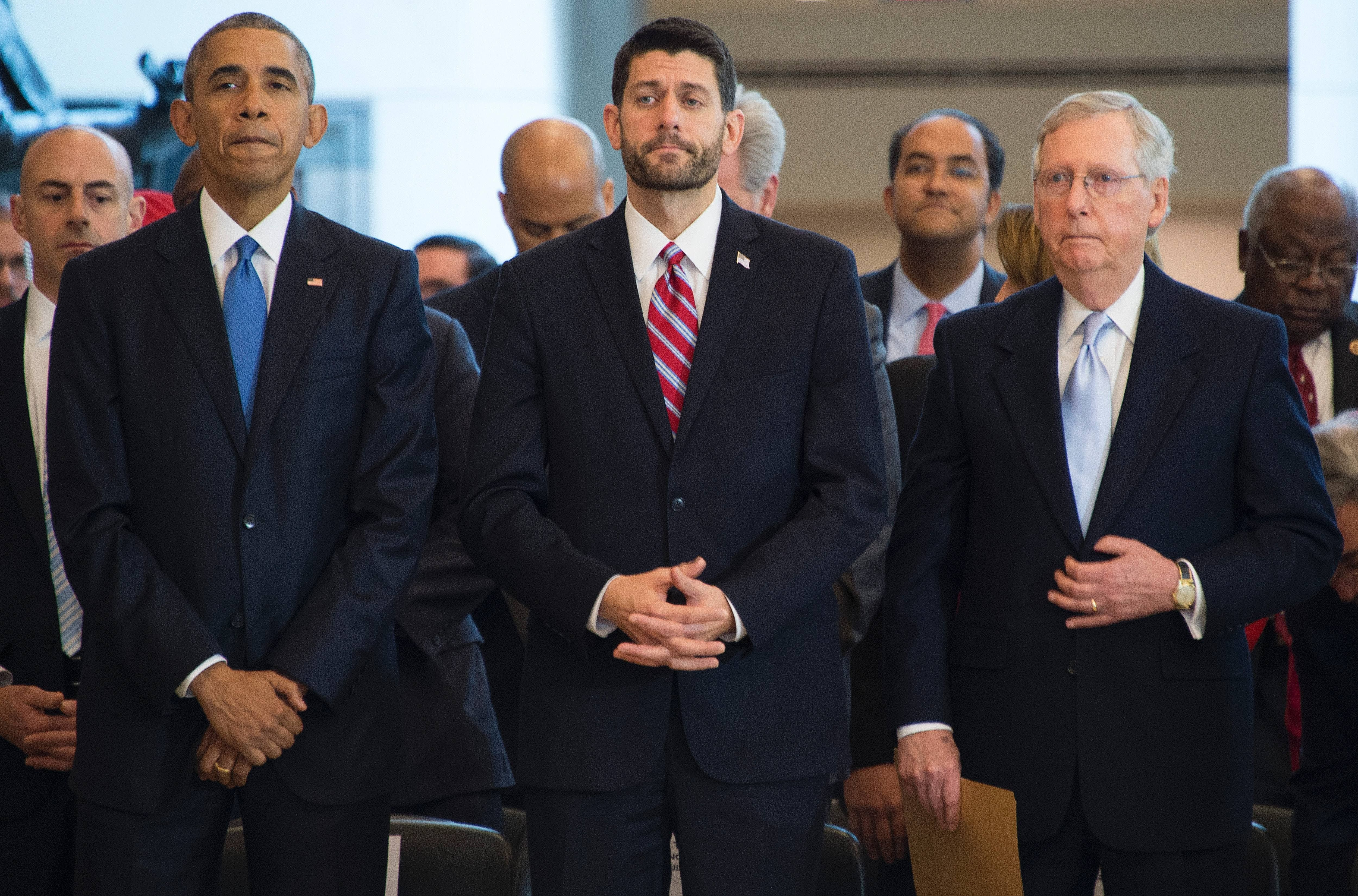 US President Barack Obama (L) stands with Speaker of the House Paul Ryan ,R-WI,(C) and Senate Majority Leader Mitch McConnell,R-KY, (R) during a ceremony commemorating the 150th anniversary of the ratification fo the 13th Amenment, abolishing slavery, at the US Capitol in Washington, DC, December 9, 2015.  AFP PHOTO / JIM WATSON / AFP / JIM WATSON        (Photo credit should read JIM WATSON/AFP/Getty Images)