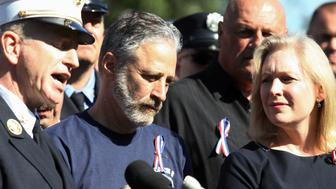 Comedian Jon Stewart stands with New York City first responders during a rally on Capitol Hill in Washington, Wednesday, September 16, 2015, calling for the extension of the the Zadroga Heath & Compensation Act that provides health care and compensation to 9/11 first responders and victims will come to an end if not renewed by Congress. (AP Photo/Lauren Victoria Burke)