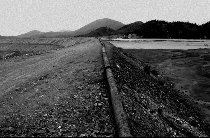 A 2-mile long pipe carrying radioactive waste stretches from the UCIL processing plant to the tailing dam,which flows i
