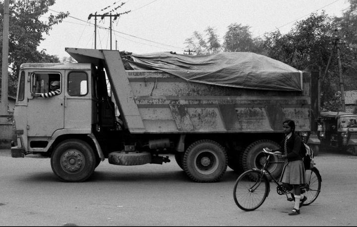 A truck transporting radioactive uranium ore passes through a town.