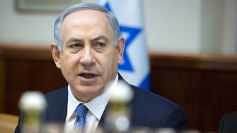 Israeli Prime Minister Benjamin Netanyahu opens the weekly cabinet meeting at his Jerusalem office on December 6, 2015.   AFP PHOTO / POOL / JIM HOLLANDER    / AFP / POOL / JIM HOLLANDER        (Photo credit should read JIM HOLLANDER/AFP/Getty Images)
