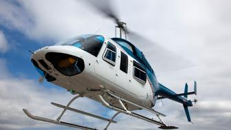 A Bell 206 helicopter in flight.