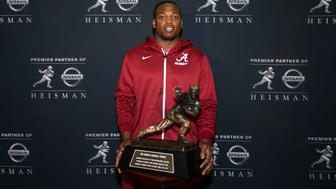 NEW YORK - DECEMBER 11: Heisman finalist Derrick Henry, running back for the University of Alabama, poses with the Heisman Trophy during media availability on December 11, 2015 at the Marriott Marquis in New York City. NOTE TO USER: Photographer approval needed for all Commercial License requests. (Photo by Kelly Kline/Getty Images for The Heisman)
