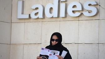 Saudi candidate Amal Badreldin al-Sawari stands outside a polling station after casting her ballot in the capital Riyadh, on December 12, 2015 during municipal elections. Saudi women were allowed to vote in elections for the first time ever, in a tentative step towards easing widespread sex discrimination in the ultra-conservative Islamic kingdom. AFP PHOTO / FAYEZ NURELDINE / AFP / FAYEZ NURELDINE        (Photo credit should read FAYEZ NURELDINE/AFP/Getty Images)