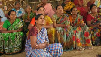 Wives of fishermen in Idinthakarai, who have been running relay hunger strikes for five years in protest at Kudankulam, listen to Udaykumar