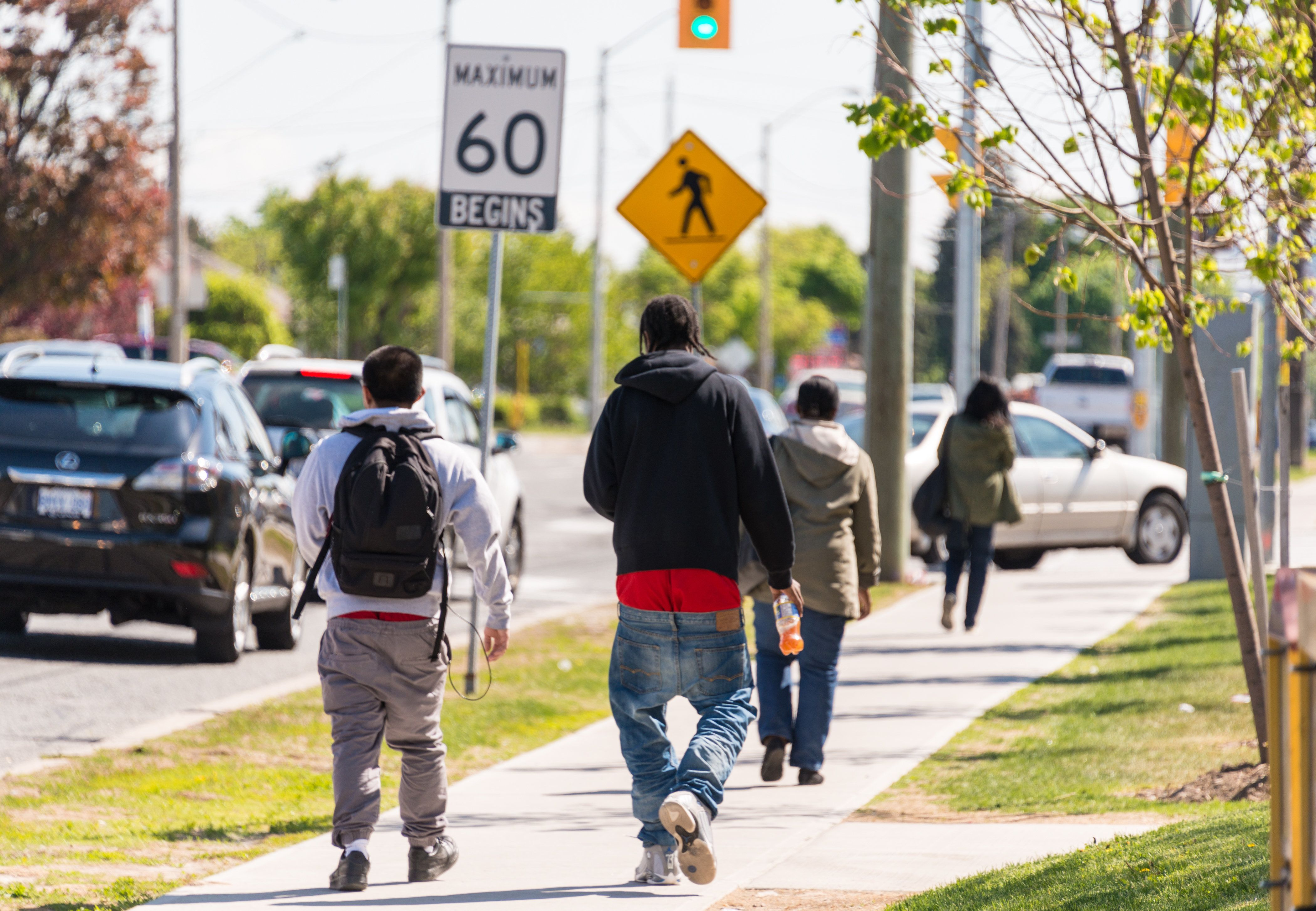 TORONTO, ONTARIO, CANADA - 2015/05/22: Youth walking on the street with low lowered pants. Sagging is a manner of wearing trousers or jeans which sag so that the top of the trousers or jeans are significantly below the waist, sometimes revealing much of the underwear. (Photo by Roberto Machado Noa/LightRocket via Getty Images)