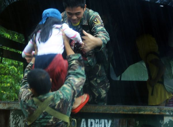 Soldiers evacuate residents from a village in Legazpi.