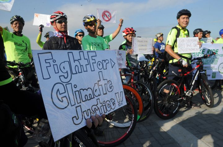 Environmentalists take part in a bicycle ride to show solidarity for the global movement for climate justice in Manila on Dec