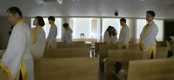 People at the Seoul Hyowon Healing Center stand by their coffins as part of a mock death ritual. Such rituals are b