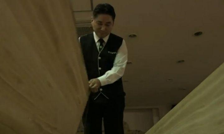 A Hyowon Healing Center program team member prepares to close a coffin.