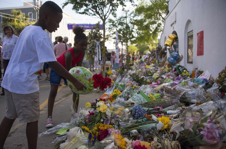 Children place flowers outside Emanuel AME Church in Charleston, South Carolina, where nine churchgoers were shot dead during