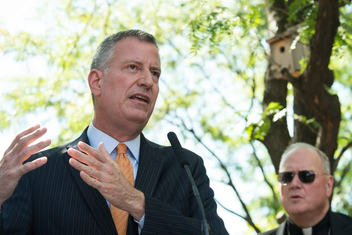 Bill de Blasio addresses the press. Mayor Bill de Blasio and Cardinal Timothy Dolan (not seen) joined with city and state off