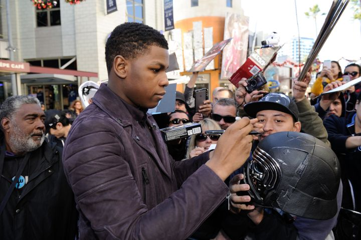 John Boyega greets fans at Universal Studios Hollywood on Dec. 14, 2015.