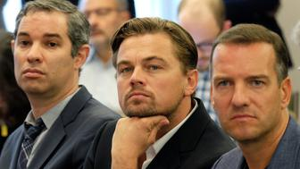 US actor Leonardo DiCaprio (C) sits in the audience during a press conference to announce further business divestment from fossil fuels in New York on September 22, 2015. AFP PHOTO/JEWEL SAMAD        (Photo credit should read JEWEL SAMAD/AFP/Getty Images)