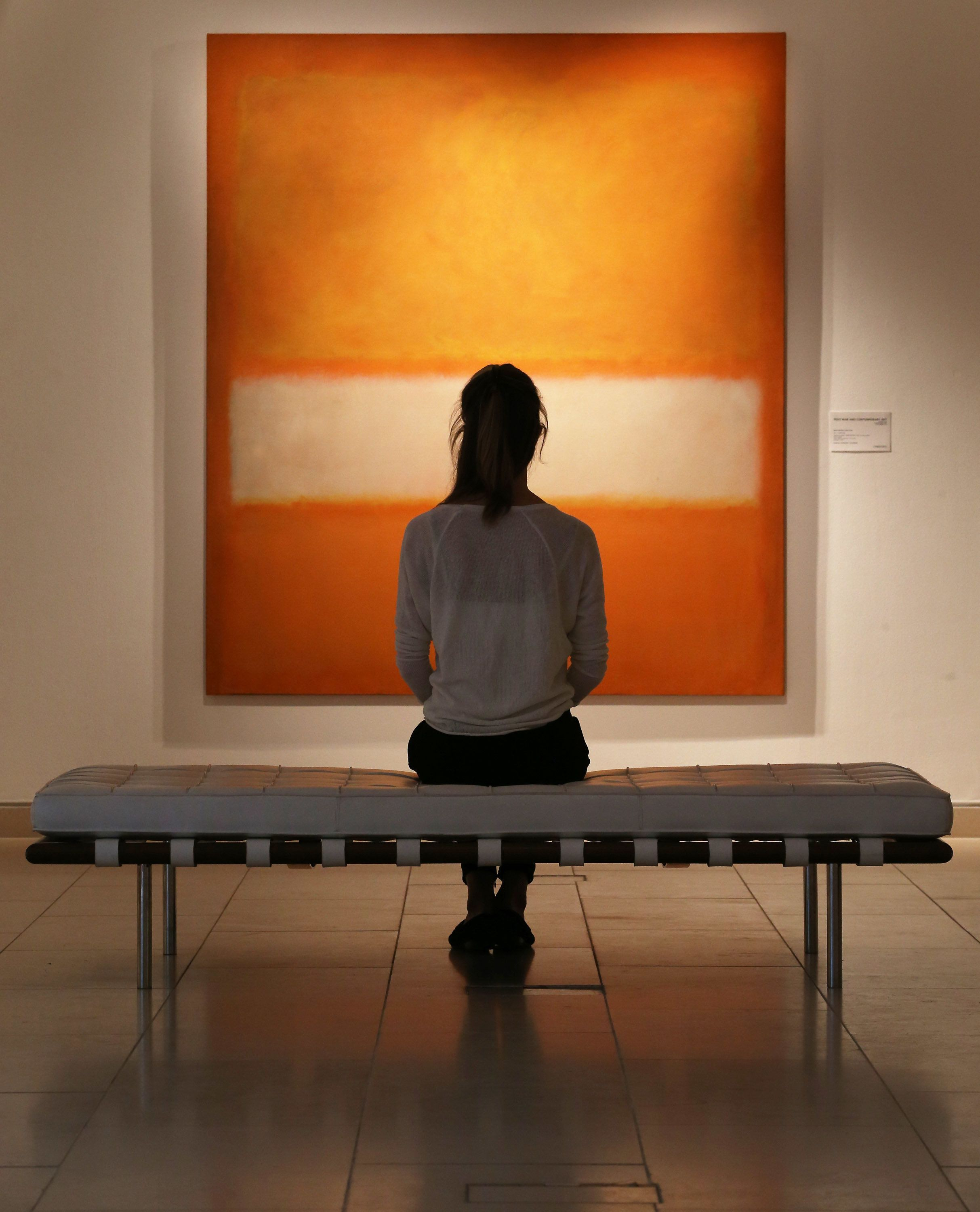 LONDON, ENGLAND - OCTOBER 14:  A member of Christie's staff looks at Mark Rothko's's 'No 11 (Untitled)' on October 14, 2013 in London, England. The work forms part of Christie's New York evening sale of post-war and contemporary art auction on November 12, 2013 and is estimated at $25-$35 million.  (Photo by Peter Macdiarmid/Getty Images)
