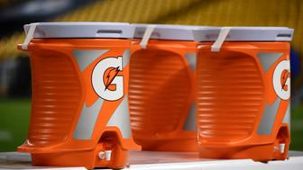 Gatorade buckets are on the sideline before an NFL football game between the Pittsburgh Steelers and the Indianapolis Colts, Sunday, Dec. 6, 2015, in Pittsburgh. (AP Photo/Fred Vuich)