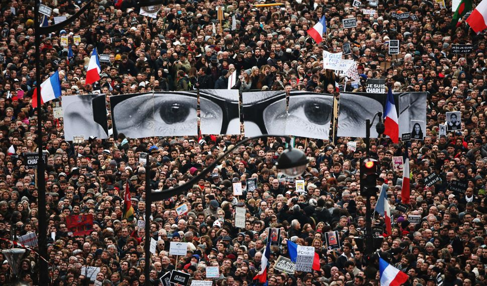 Hundreds of thousands of people flood the streets of Paris to express support in the wake of two deadly terror attacks i