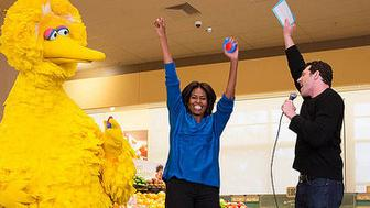 """First Lady Michelle Obama participates in a """"Let's Move!"""" Funny or Die game show taping with Billy Eichner of Billy on the Street, and Big Bird at Safeway in Washington, D.C., Jan. 12, 2015. (Official White House Photo by Amanda Lucidon)"""