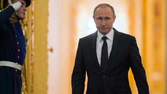 MOSCOW, Dec. 3, 2015-- Russian President Vladimir Putin walks into the hall to deliver the annual State of the Union address in Kremlin, Moscow, Russia, on Dec. 3, 2015. (Xinhua/Sputnik via Getty Images)