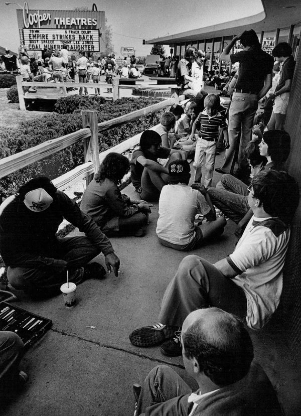 """People wait to get into a screening of """"Star Wars: The Empire Strikes Back"""" on May 22, 1980."""