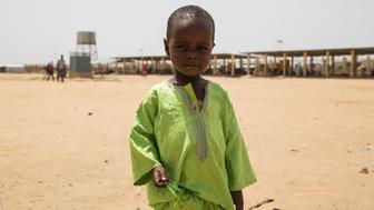 N'DJAMENA, CHAD - JUNE 22:  A Chadian kid holds bottle taps at a slumdog of N'djamena, Chad on June 22, 2015. Referred to as the 'Dead Heart of Africa', the majority of Chads population does not respect the rights of children. One of the main problems faced by children is poverty. Chad, a crossing point between sub-Saharan Africa and North Africa, is one of the poorest countries in the world. Thus, poverty, which affects a vast majority of young Chadians, has serious repercussions on their access to a healthy diet, adequate financial resources, healthcare, etc. Also, in Chad, the mortality rate of children under five is very worrisome. In fact, due to the lack of sanitation, drinking water and healthcare in rural areas, 209 children out of 1000 die every year. Another problem is education. The population of Chad is so disparate that Childrens Rights to education are compromised. In addition, parents are often reluctant to send their children to school. Only a small percentage of children in Chad are schooled. Crucial problem is child marriages. The marriage of young girls is still a common practice in Chad, as the age of majority is set differently within various documents. From a legal point of view, civil majority is reached at 21 years and the legal age of marriage is set at 15 years for girls and 18 years for boys. However in customary law, the age of marriage is implicitly set at 13 years, which goes against the International Convention on the Rights of the Child. Other issue is child labor. In Chad, the minimum age for employment is 14 years. However, due to economic difficulties, many families are often forced to make their children work. (Photo by Orhan Cicek/Anadolu Agency/Getty Images)