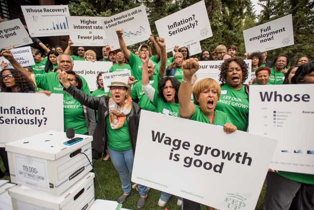 Members of the Fed Up campaign, a coalition of progressive groups opposed to an interest rate hike, demonstrate...