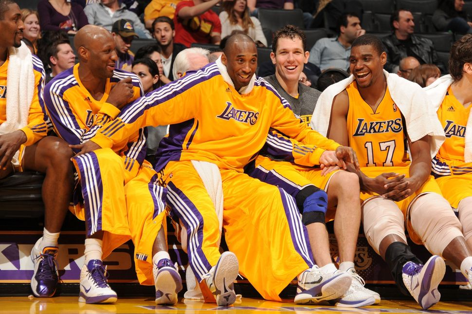 Bryant, Andrew Bynum, Lamar Odom, Metta World Peace and Luke Walton laugh on the bench during a game against the Utah Ja