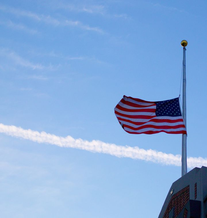 An American flag flies at half mast. A HuffPost/YouGov poll shows Americans concerned about terrorism and gun violence, but m
