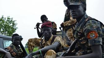 South Sudanese SPLA soldiers are pictured in Pageri in Eastern Equatoria state on August 20, 2015. The spokesman of SPLA, Colonel Philip Aguer visited the area after the government claimed to be back in control of the area following an attack by rebel forces. South Sudan's civil war began in December 2013 when Kiir accused his former deputy Riek Machar of plotting a coup, setting off a cycle of retaliatory killings that has split the poverty-stricken country along ethnic lines. The government says they will return to talks in Ethiopia in early September to 'finalise' a peace deal. AFP PHOTO / SAMIR BOL        (Photo credit should read SAMIR BOL/AFP/Getty Images)