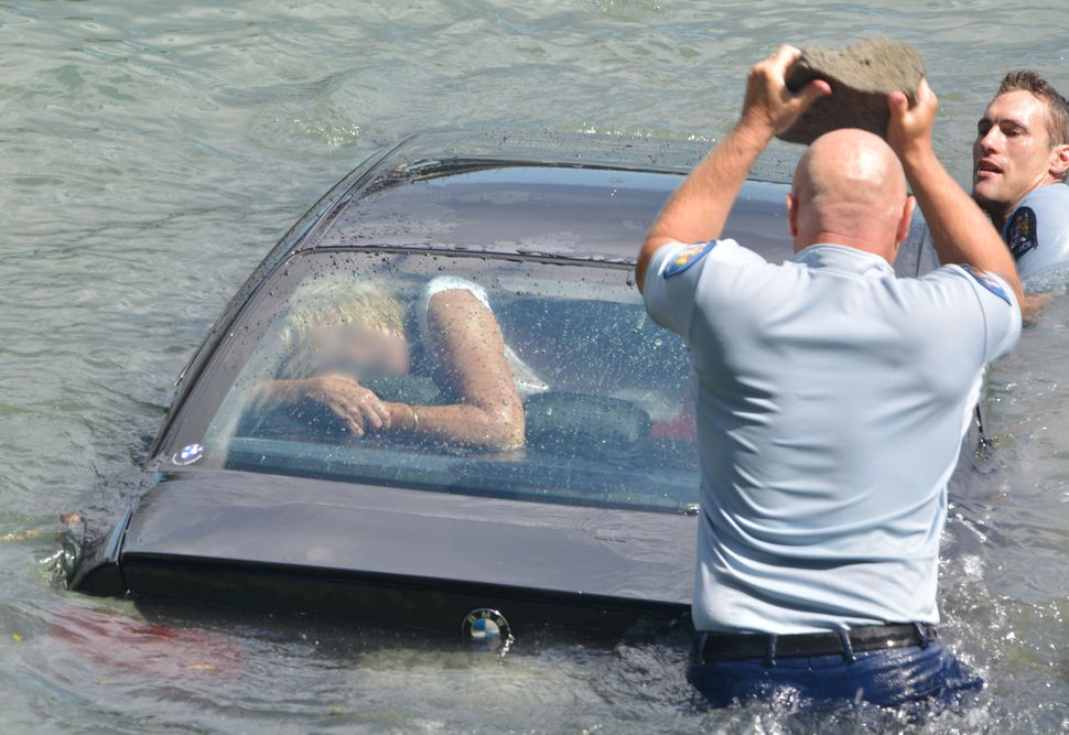 "Rescuers save a woman&nbsp;whose car had <a href=""https://www.huffpost.com/entry/police-rescue-drowning-woman-from-car_n_6699"