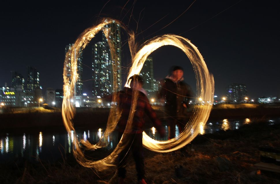 People celebrate Daeboreum, a holiday marking the first full moon of the lunar new year, in Seoul, South Korea, on March