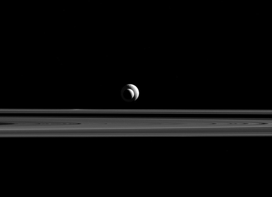 Enceladus and Tethys, moons of Saturn.