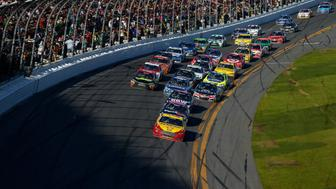 Joey Logano, driver of the #22 Shell-Pennzoil Ford,  leads a pack of cars during the NASCAR Sprint Cup Series 57th Annual Daytona 500 at Daytona International Speedway on February 22, 2015 in Daytona Beach, Florida.
