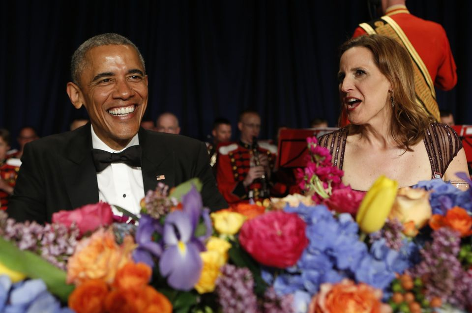 US President Barack Obama (L) speaks with White House Correspondents' Association (WHCA) President Christi Parsons at the WHC
