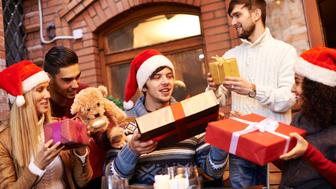 Five young friends giving each other Christmas gifts